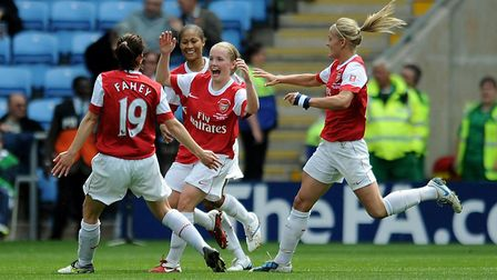 Arsenal's Kim Little (centre) celebrates with her team mates after scoring the opening goal of the g