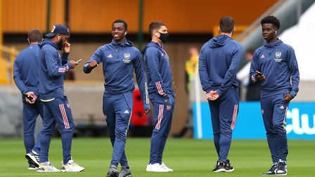 Arsenal players inspect the pitch before the Premier League match at Molineux