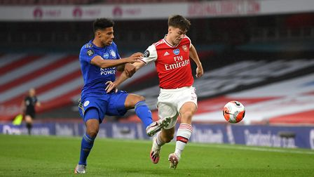 Leicester City's James Justin (left) and Arsenal's Kieran Tierney (right) battle for the ball