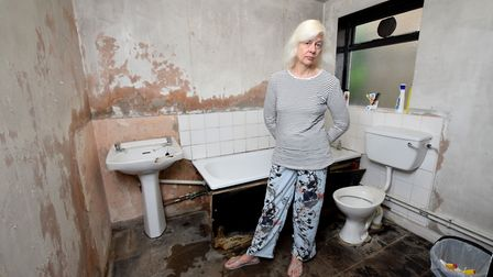 An Islington Council house resident in her bathroom, which is maintained with the PFI2 contract. Pic
