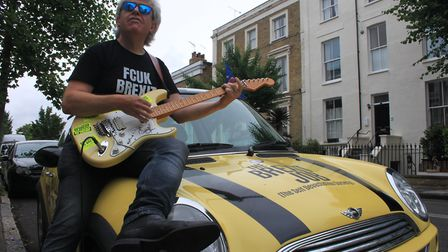 "Peter Cook outside Dominic Cummings' home with the ""B*llocks to Brexit"" car. Picture: Danny Halpin"