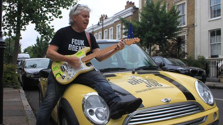 """Peter Cook outside Dominic Cummings' home with the """"B*llocks to Brexit"""" car. Picture: Danny Halpin"""