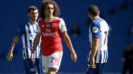 Arsenal's Matteo Guendouzi (left) argues with Brighton & Hove Albion's Neal Maupay after the Premier