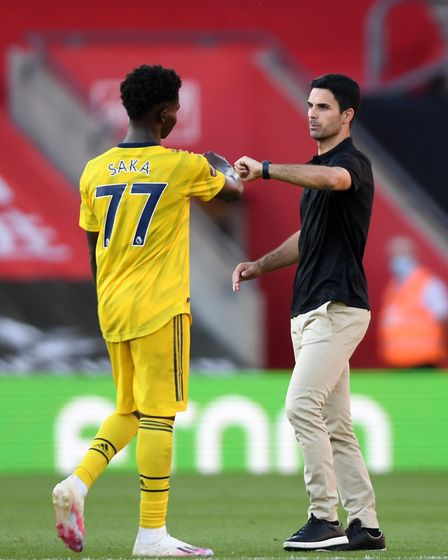 Arsenal manager Mikel Arteta (right) fist bumps Bukayo Saka (left) after the Premier League match at