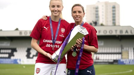 Arsenal's Leah Williamson (left) and Jordan Nobbs celebrate with the FA Women's Super League trophy