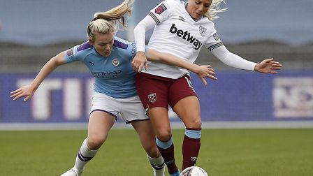 Manchester City's Lauren Hemp battles for the ball with West Ham's Adriana Leon (right) during the F