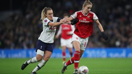 Tottenham Hotspur'�s Josie Green (left) and Arsenal'�s Vivanne Miedema battle for the ball
