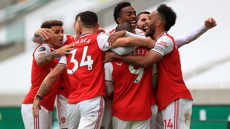 Arsenal's Alexandre Lacazette is mobbed by team-mates after scoring his side's second goal against W