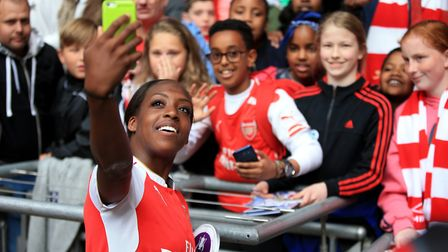 Arsenal's Danielle Carter take a photograph of herself and fans (pic Nick Potts/PA)