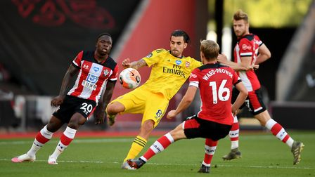 Arsenal's Dani Ceballos battles for the ball with Southampton's James Ward-Prowse (right) and Michae