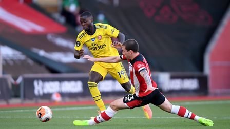 Arsenal's Nicolas Pepe (left) and Southampton's Pierre-Emile Hojbjerg (right) battle for the ball