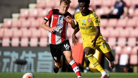 Southampton's James Ward-Prowse (left) and Arsenal's Bukayo Saka (right) battle for the ball