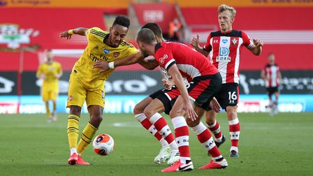 Arsenal's Pierre-Emerick Aubameyang battles for the ball with three Southampton players