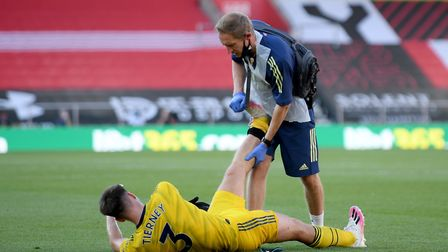 Arsenal's Kieran Tierney receives treatment on the pitch during the Premier League match at St Mary'