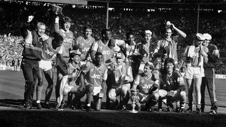 Arsenal celebrate winning the 1987 Littlewoods Cup after their 2-1 victory over Liverpool, back row,