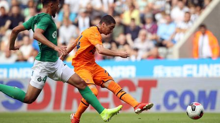 Newcastle United's Miguel Almiron (right) and Saint Etienn's William Saliba battle for the ball duri