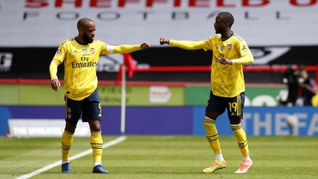 Arsenal's Nicolas Pepe (right) celebrates scoring his side's first goal of the game during the FA Cu