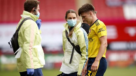 Arsenal's Kieran Tierney receives medical treatment during the FA Cup quarter final match at Bramall