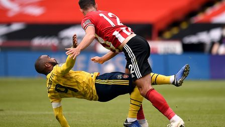 Arsenal's Alexandre Lacazette is blocked by Sheffield United's John Egan during the FA Cup quarter f