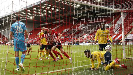Sheffield United celebrate with the ball in the net only for VAR to disallow the goal during the FA