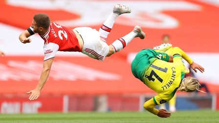 Arsenal's Shkodran Mustafi and Norwich City's Todd Cantwell battle for the ball