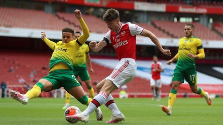 Arsenal's Kieran Tierney and Norwich City's Max Aarons battle for the ball
