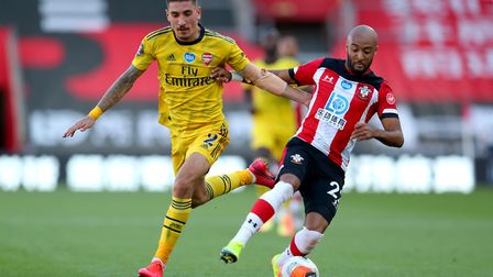 Southampton's Nathan Redmond and Arsenal's Hector Bellerin (left) battle for the ball