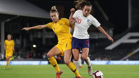 Australia's Steph Catley battles for the ball with England's Lucy Staniforth during an international