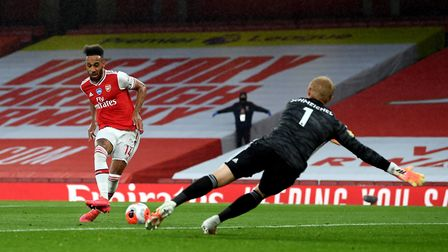 Arsenal's Pierre-Emerick Aubameyang scores against Leicester during the Premier League match at the