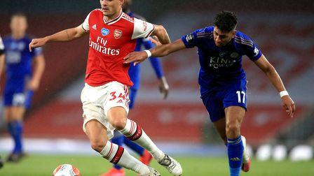 Arsenal's Granit Xhaka (left) and Leicester City's Ayoze Perez battle for the ball