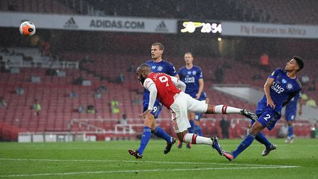 Arsenal's Alexandre Lacazette has a headed attempt on goal during the Premier League match at the Em