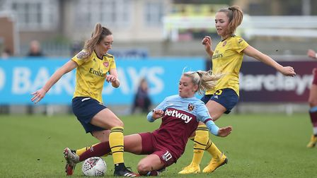 Julia Simic of West Ham and Lisa Evans of Arsenal battle for the ball (pic Gavin Ellis/TGS Photo)