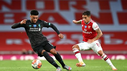 Liverpool's Alex Oxlade-Chamberlain (left) and Arsenal's Lucas Torreira battle for the ball