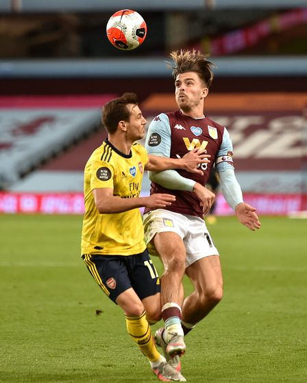 Aston Villa's Jack Grealish (right) and Arsenal's Cedric Soares battle for the ball