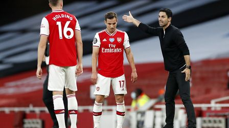 Arsenal manager Mikel Arteta (right) speaks to Rob Holding and Cedric Soares