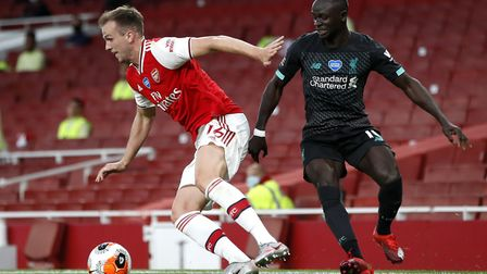 Arsenal's Rob Holding (left) and Liverpool's Sadio Mane battle for the ball