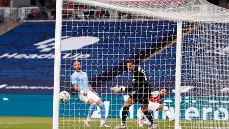 Pierre-Emerick Aubameyang (right) puts Arsenal ahead against Manchester City in their FA Cup semi-fi