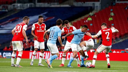 Manchester City's Gabriel Jesus (third right) battles with the Arsenal defence