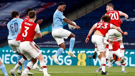Manchester City's Raheem Sterling (centre) in action during the FA Cup semi-final