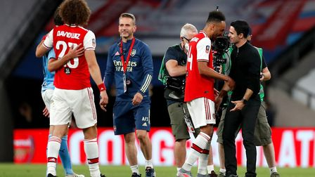 Arsenal manager Mikel Arteta (right) and Pierre-Emerick Aubameyang celebrate victory