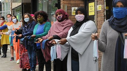 Cllr Asima Shaikh with members of the community sewing groups wearing their masks. Picture: Islingto