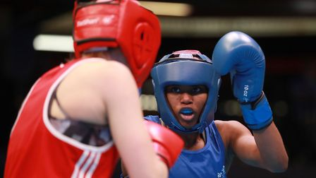 Great Britain's Caroline Dubois (blue) on her way to defeating Bealus' Ala Staradub (red) during day