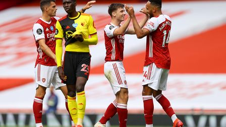 Arsenal's Kieran Tierney (second right) celebrates scoring his side's second goal of the game with t