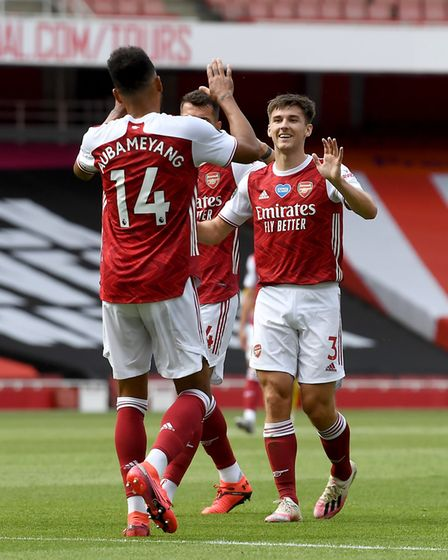 Kieran Tierney celebrates scoring his first goal for Arsenal against Watford with team-mate Pierre-E