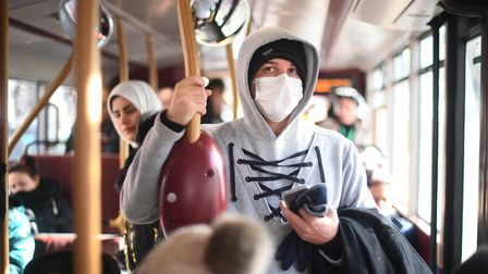 Stock image of man on bus wearing protective mask amid coronavirus panic in UK. Picture: Victoria Jo