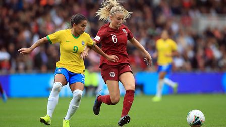 Brazil's Oliveira Debora and England's Leah Williamson (right) during the International Friendly mat
