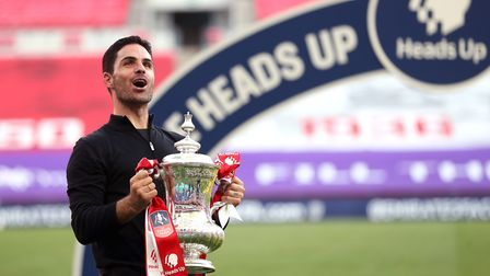 Arsenal manager Mikel Arteta celebrates their victory with the FA Cup trophy after the Heads Up FA C