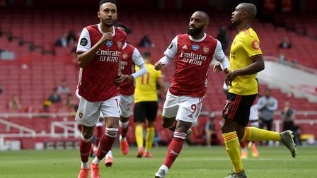 Arsenal's Pierre-Emerick Aubameyang (left) celebrates scoring his side's first goal of the game