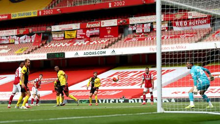 Arsenal's Kieran Tierney (third left) scores his side's second goal of the game