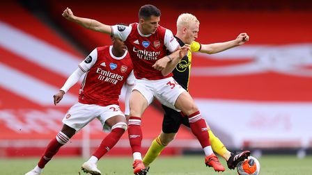 Arsenal's Granit Xhaka (left) and Watford's Will Hughes battle for the ball